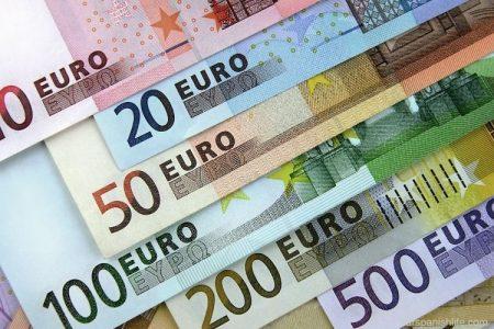 Does Spain use Euros or Pesos?